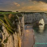 White cliffs and natural rock arch in Etretat France