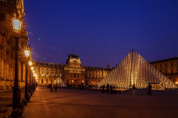 Museum Louvre by night in Paris France