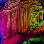 Colorful lighting on speleothem in Silver Cave