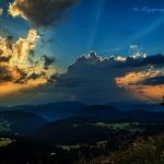 Sunset clouds at Carezza Trentinos in Dolomite Italy